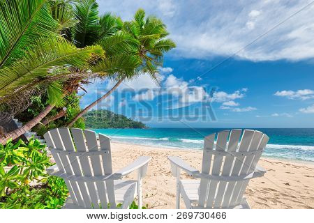 Beach Chairs On Beautiful Sandy Beach With Palm And Turquoise Sea On Jamaica Paradise Island. Summer