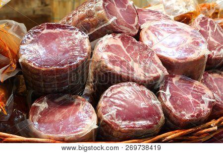 Salami With Nylon For Sale In The Italian Delicatessen Made Also Called Capocollo Or Coppa