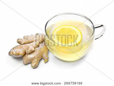Ginger Tea With Lemon Slice And Glass Cup. Healthy Tea Time With Fresh Ginger Root. Natural Medicine