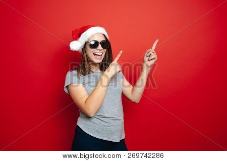 Young Cheerful Woman Pointing Away At Copyspace