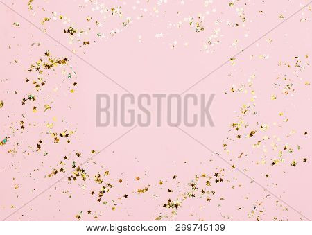 Pink Confetti And Stars And Sparkles On Pink Background. Top View, Flat Lay. Copyspace For Text. Bri