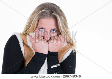Middle Aged Blond Forties Woman Is Hiding Her Mouth In Her Winter Jacket