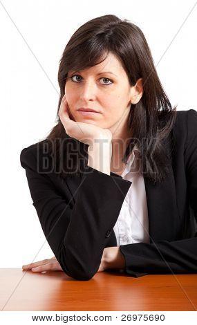 Bored businesswoman on the desk