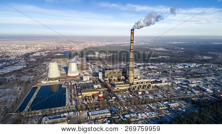 Garbage Incineration Plant. Waste Incinerator Plant With Smoking Smokestack. The Problem Of Environm