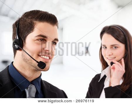 Friendly phone operator at work in an office environment.
