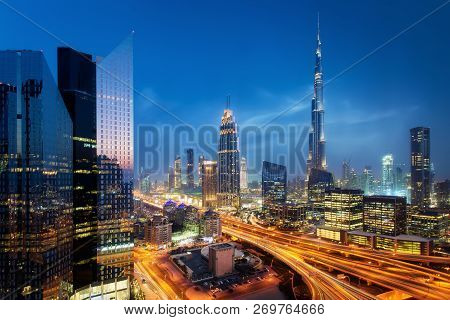 Beautiful Aerial View To Dubai Downtown City Center Lights Skyline At Night, United Arab Emirates. L