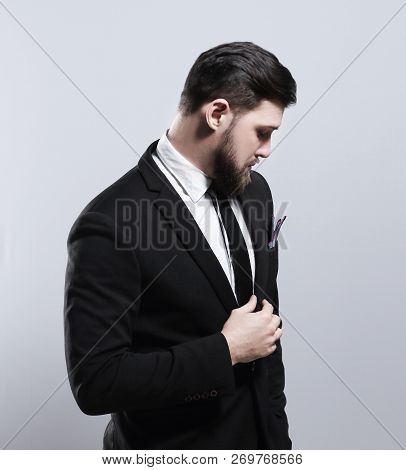 Confidence And Charisma. Handsome Young Man In Full Suit Adjusting His Jacket