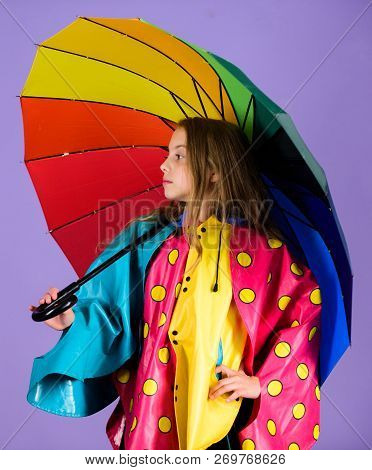 Waterproof accessories make rainy day cheerful and pleasant. Kid girl happy hold colorful umbrella wear waterproof cloak. Enjoy rainy weather with proper garments. Waterproof accessories for children poster