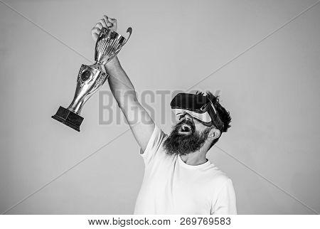 Championship Online. Man Bearded Hipster Vr Headset Holds Golden Goblet. Feel Victory In Virtual Rea