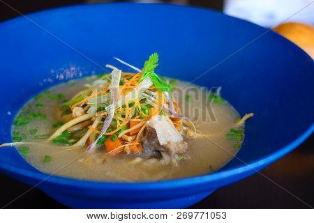 Ginseng Oxtail Soup Herb Boiled Oxtail With Ginseng Served With Mixed Vegetables And Bun