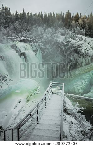Biggest Frozen Swedish Waterfall Tannforsen In Winter Time