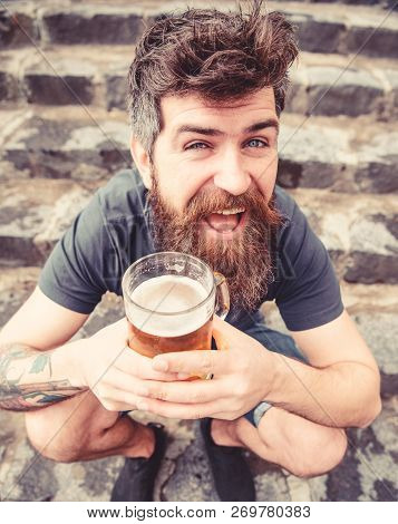 Guy Having Rest With Draught Beer. Hipster On Cheerful Face Drinking Beer Outdoor. Man With Beard An