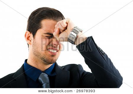 Angry businessman hitting his head with a punch