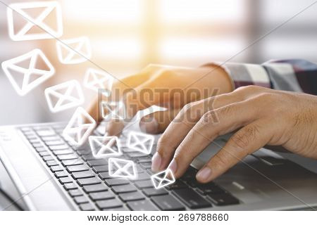 Email Marketing Concept. Sending Newsletter. Man Typing On Laptop