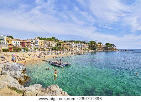 Calella De Palafrugell, Spain - September 15, 2018. Tourists Enjoying A Sunbathing In Platja Del Can
