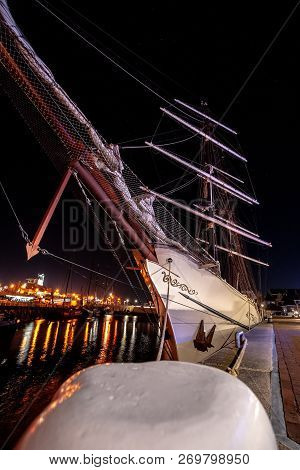 Old Classic Sailing Ship With Imposing Masts Full Of Sails And A Streamlined Bow. Historic Whaling S