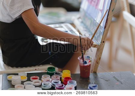 Little Girl Painting A Picture In A Studio Or Art School. Creative Pensive Painter Child Paints A Co