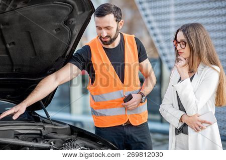 Handsome Service Worker Consulting Or Providing Technical Assistance Of The Broken Car To The Busine