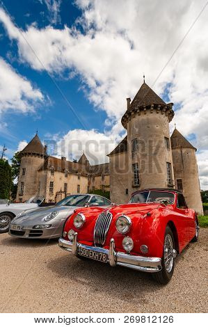 Beaune, France - June 12, 2010: Red Classic Jaguar Xk 140 Sportscar In Front Of The Savigny Castle.