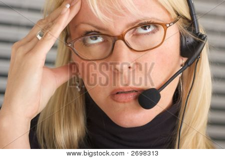 Businesswoman With Phone Headset Has Headache