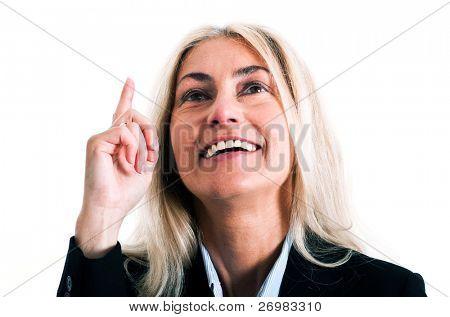 Smiling businesswoman having an idea