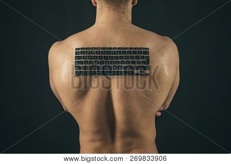 Testosterone Booster. Man Of Muscle. Man With Keyboard Keys On Muscular Back. Strong Man With Comput