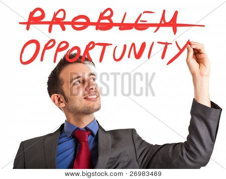 Young positive businessman writing a positive concept on the screen