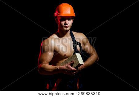 When It Comes To Construction We Do It All. Man Worker Hold Brick In Muscular Hands. Construction Wo