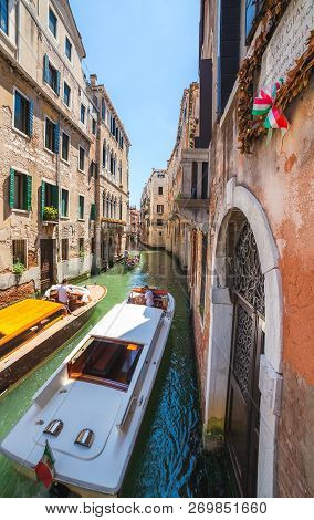 Venice, Italy - June 15, 2016: Two Boats Meet In Small Canal  Called Rio Del S.luca Nearby Campo Man