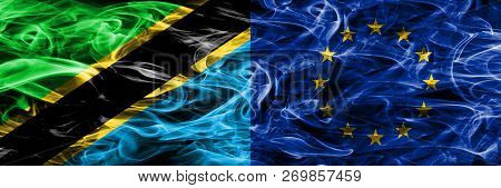 Tanzania Vs European Union, Eu Smoke Flags Placed Side By Side. Thick Colored Silky Smoke Flags Of T