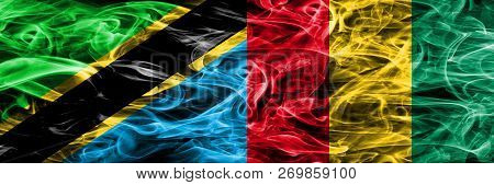 Tanzania Vs Guinea, Guinean Smoke Flags Placed Side By Side. Thick Colored Silky Smoke Flags Of Tanz