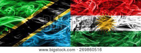 Tanzania Vs Kurdistan, Kurdish Smoke Flags Placed Side By Side. Thick Colored Silky Smoke Flags Of T