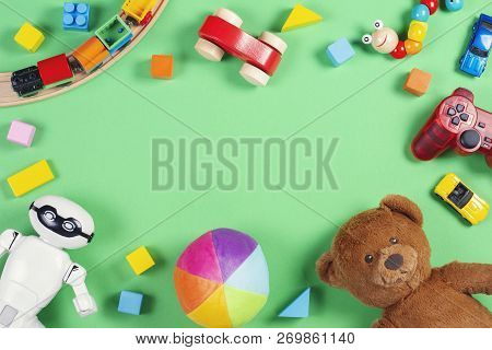 Baby Kids Toys Frame With Teddy Bear, Toy Cars, Robot, Colorful Bricks, Cubes On Pink Background