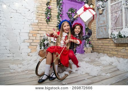 Christmas Is Already Here. Girl Sledding With Christmas Gift Box. Small Cute Girls Received Holiday