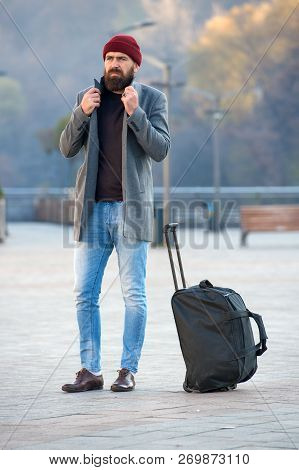 Looking For Accommodation. Man Bearded Hipster Travel With Big Luggage Bag Wait For Taxi Bring Him T
