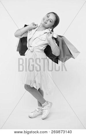 Kid In Shop. Happy Kid In Shop With Bags. Beautiful Little Kid Girl In Shop. Kid Shop Concept. Shopp