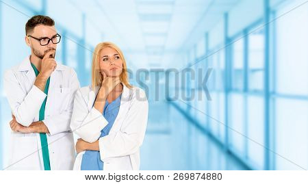 Doctors Working With Colleague In The Hospital.