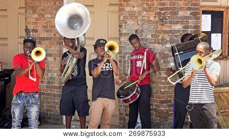 New Orleans, Louisiana - May 7th: Young Street Performers Play Music For Tips In The Historic French