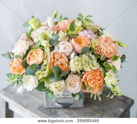 Bouquet Of Fresh Spring Flowers On Gray Wall Background. Floral Arrangement In Vintage Metal Vase. F