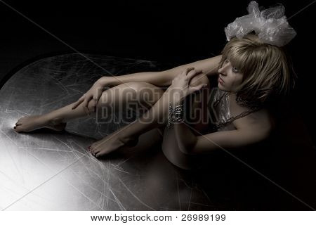 Picture of a beautiful blonde girl in the image of crazy. drabble ink for eyelashes and shaggy hair.