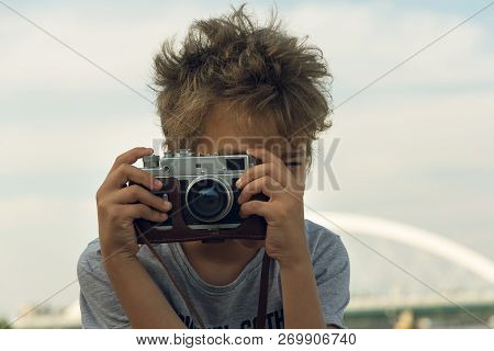 Boy Photographer With Vintage Camera. Boy Using Vintage Camera Lifestyle. People Vintage Lifestyle.