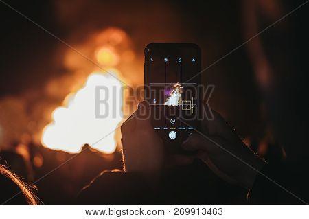London, Uk - November 3, 2018: Man Taking Photo Of Bonfire On Mobile Phone At Guy Fawkes Night Yearl