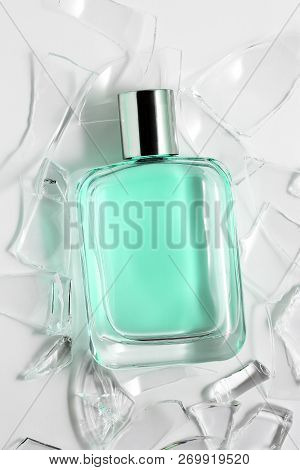 Perfume Bottle With Broken Glass On White