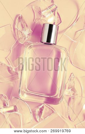 Perfume Bottle With Broken Glass On Pink