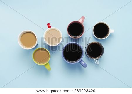 Many Multicolored Cups Of Coffee And Coffee Drinks On A Blue Background. Concept Breakfast With Coff