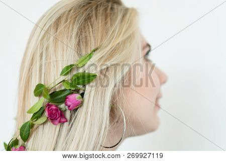 Hairdressing Art. Creative Hairstyling. Romantic Summer Updo With Floral Accessories. Blond Girl Wea