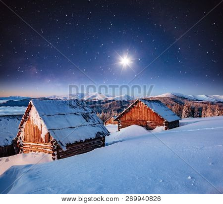View at the starry sky over snowy hills. Dramatic and exotic scene. Location place Carpathian mountains, Ukraine, Europe. Astrophotography of milkyway. Winter wallpaper. Discover the beauty of earth.