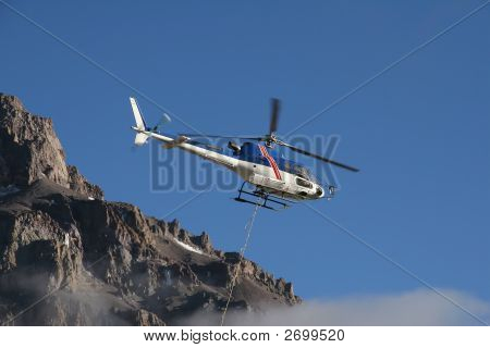 Helicopter picking up supplies from Plaza de Argentina Base Camp on Aconcagua poster