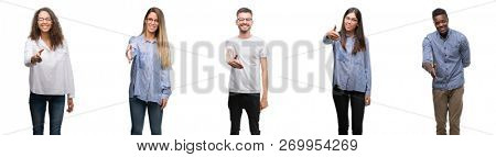 Group and team of young business people over isolated white background smiling friendly offering handshake as greeting and welcoming. Successful business.