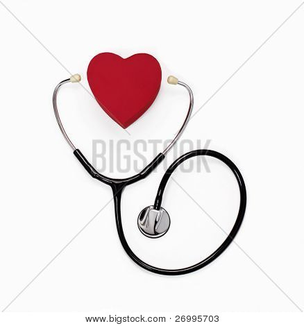 Stethoscope and heart on white